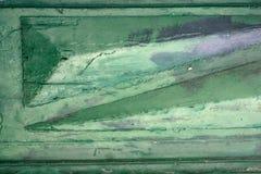 Αφηρημένο υπόβαθρο μιας ξύλινης επιφάνειας με τα στοιχεία ανακούφισης, που χρωματίζεται σε ένα ελαφρύ σμαραγδένιο χρώμα, με τα γκ Στοκ Φωτογραφίες