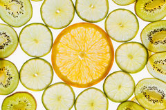 Αφηρημένο υπόβαθρο, πορτοκάλι, ασβέστες και ακτινίδιο σχεδίων φετών φρούτων Στοκ Φωτογραφία