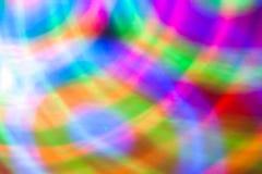 Αφηρημένο υπόβαθρο των χρωματισμένων φω'των σε μια κίνηση Στοκ Εικόνες