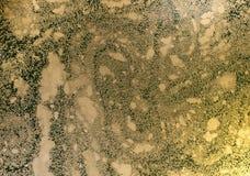 Αφηρημένο υπόβαθρο Υγρό μαρμάρινο σχέδιο γυαλισμένη μάρμαρο σύσταση επιφάνειας πετρών Χρυσό μαρμάρινο σκηνικό σκόνης Στοκ Εικόνες