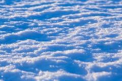 Αφηρημένο υπόβαθρο χιονιού στα φω'τα ηλιοβασιλέματος Στοκ φωτογραφία με δικαίωμα ελεύθερης χρήσης