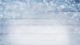 Αφηρημένο χειμερινό υπόβαθρο με τις ξύλινες σανίδες και τις νιφάδες χιονιού στοκ φωτογραφία με δικαίωμα ελεύθερης χρήσης