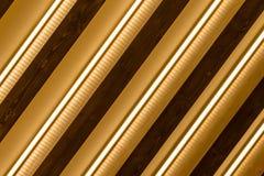 Αφηρημένο χρυσό, ξύλινο και ελαφρύ ριγωτό υπόβαθρο Στοκ Φωτογραφίες