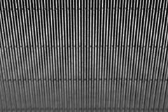Αφηρημένο minimalistic σκοτεινό ριγωτό υπόβαθρο με τις κάθετες γραμμές και την επιγραφή Στοκ Εικόνα