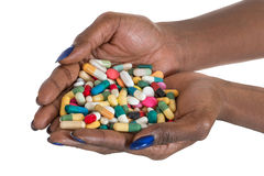 Αφθονία εκμετάλλευσης χεριών της αφρικανικής γυναίκας των χαπιών Στοκ Εικόνες