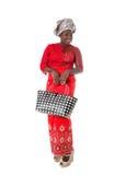 Αφρικανική γυναίκα στον παραδοσιακό ιματισμό με την τσάντα tote απομονωμένος Στοκ εικόνα με δικαίωμα ελεύθερης χρήσης