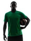 Αφρικανική σκιαγραφία ποδοσφαίρου εκμετάλλευσης ποδοσφαιριστών ατόμων Στοκ εικόνες με δικαίωμα ελεύθερης χρήσης
