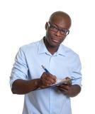 Αφρικανικός επιχειρηματίας με την περιοχή αποκομμάτων Στοκ εικόνες με δικαίωμα ελεύθερης χρήσης