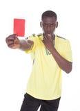 Αφρικανικός διαιτητής που παρουσιάζει κόκκινη κάρτα Στοκ Φωτογραφία