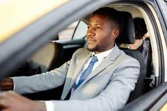 Αφρικανικό Drive αυτοκίνητο επιχειρηματιών Στοκ Φωτογραφίες