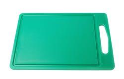 Αχρησιμοποίητος πλαστικός πράσινος τέμνων πίνακας που απομονώνεται πέρα από το άσπρο υπόβαθρο στοκ εικόνα