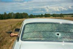 Αψιμαχία, αυλάκωμα και πυροβολισμός στο αυτοκίνητο Στοκ φωτογραφία με δικαίωμα ελεύθερης χρήσης