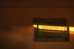 αύριο Η επιγραφή σε μια ηλιαχτίδα Στοκ Φωτογραφία