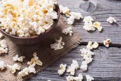 Αλατισμένο popcorn υπόβαθρο Στοκ Εικόνες