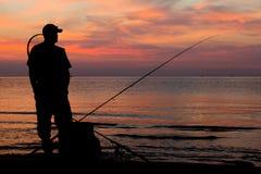 Αλιεία στο ηλιοβασίλεμα Στοκ εικόνα με δικαίωμα ελεύθερης χρήσης
