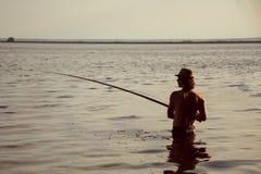 Αλιεία στο ηλιοβασίλεμα Στοκ Εικόνες