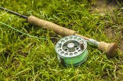 Αλιεύοντας εξέλικτρο και ράβδος Στοκ Φωτογραφίες
