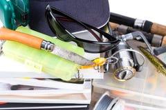 Αλιεύοντας εξοπλισμοί και δολώματα με την ΚΑΠ στα βιβλία Στοκ Φωτογραφίες