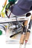 Αλιεύοντας εξοπλισμοί και δολώματα με την ΚΑΠ στα βιβλία Στοκ εικόνες με δικαίωμα ελεύθερης χρήσης