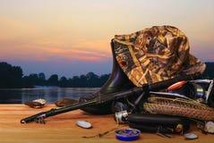 Αλιεύοντας εξοπλισμός και ηλιοβασίλεμα Στοκ Φωτογραφίες