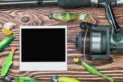 Αλιεύοντας εξοπλισμός και photoframe Στοκ εικόνα με δικαίωμα ελεύθερης χρήσης