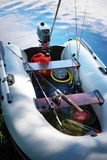Αλιεύοντας τις ράβδους με την περιστροφή των εξελίκτρων στη βάρκα Στοκ Εικόνα