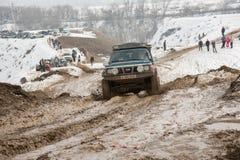 Αλμάτι, Καζακστάν - 21 Φεβρουαρίου 2013. Πλαϊνός αγώνας στα τζιπ, ανταγωνισμός αυτοκινήτων, ATV. Παραδοσιακή φυλή Στοκ Εικόνες