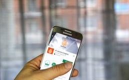 Αλ Τζαζίρα στα αγγλικά app στο αρρενωπό τηλέφωνο Στοκ Φωτογραφία
