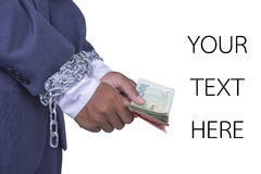 Αλυσοδεμένα χρήματα εκμετάλλευσης Businessmans χέρια Στοκ Εικόνες