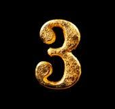 Αλφάβητο και αριθμοί στο χρυσό φύλλο Στοκ Φωτογραφίες
