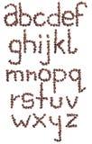 Αλφάβητο που γίνεται από τα φασόλια καφέ η ανασκόπηση απομόνωσε το λευκό Στοκ Εικόνες
