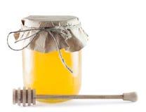 Βάζα του μελιού και του ξύλινου ραβδιού Στοκ Εικόνες