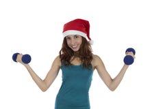 Βάρη ανύψωσης γυναικών ικανότητας Χριστουγέννων Στοκ φωτογραφία με δικαίωμα ελεύθερης χρήσης