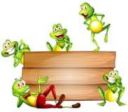 Βάτραχοι και σημάδι Στοκ Εικόνες
