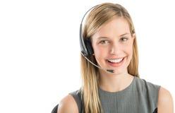 Βέβαια αντιπροσωπευτική φορώντας κάσκα εξυπηρέτησης πελατών Στοκ Φωτογραφία