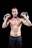 Βέβαια εκμετάλλευση αθλητικών τύπων γυμνοστήθων kettlebell Στοκ Φωτογραφίες