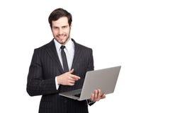 Βέβαιος επιχειρηματίας με ένα lap-top Στοκ Φωτογραφία