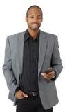 Βέβαιος επιχειρηματίας με το κινητό τηλέφωνο Στοκ Εικόνες