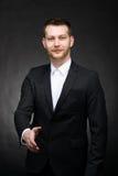 Βέβαιος επιχειρηματίας που φθάνει έξω στο χέρι Στοκ Εικόνες