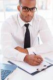 Βέβαιος επιχειρηματίας στην εργασία Στοκ Εικόνα