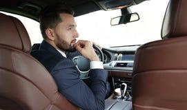 Βέβαιος επιχειρηματίας στο αυτοκίνητό του Στοκ φωτογραφία με δικαίωμα ελεύθερης χρήσης