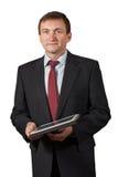 Βέβαιος ώριμος επιχειρηματίας που κρατά ένα απομονωμένο σημειωματάριο portra Στοκ εικόνα με δικαίωμα ελεύθερης χρήσης