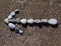 Βέλος των πετρών στην άμμο Στοκ Φωτογραφίες