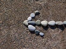 Βέλος των πετρών στην άμμο Στοκ Εικόνα
