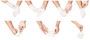 Βήμα του χεριού που ρίχνει μακριά τα άσπρα μίας χρήσης γάντια ιατρικά στοκ εικόνες