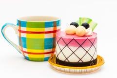 βακκίνιο cupcake με το μαύρο καφέ στην κούπα καφέ χρώματος Στοκ εικόνες με δικαίωμα ελεύθερης χρήσης