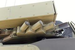 Βαριά στρατιωτική έκθεση εξοπλισμού Δεξαμενή στρατού με τα πυροβόλα όπλα στοκ εικόνα με δικαίωμα ελεύθερης χρήσης