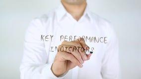 Βασικοί δείκτες απόδοσης, άτομο που γράφουν στο γυαλί Στοκ εικόνα με δικαίωμα ελεύθερης χρήσης