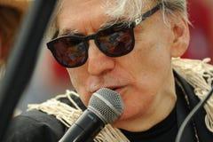 Βασιλιάς Ποσειδώνας Chris Stein Blondie που μιλά στο μικρόφωνο στη 35η ετήσια παρέλαση γοργόνων Στοκ εικόνα με δικαίωμα ελεύθερης χρήσης