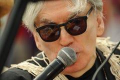 Βασιλιάς Ποσειδώνας Chris Stein Blondie που μιλά στο μικρόφωνο στη 35η ετήσια παρέλαση γοργόνων Στοκ Εικόνα
